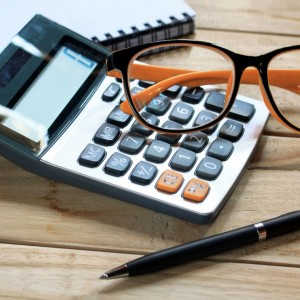 Calculator on desk, CPA firm Smith and West breathes sigh of relief after implementing Versature