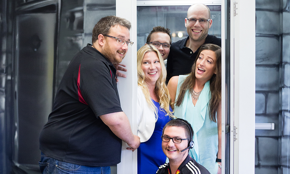 Versature team in the phone booth