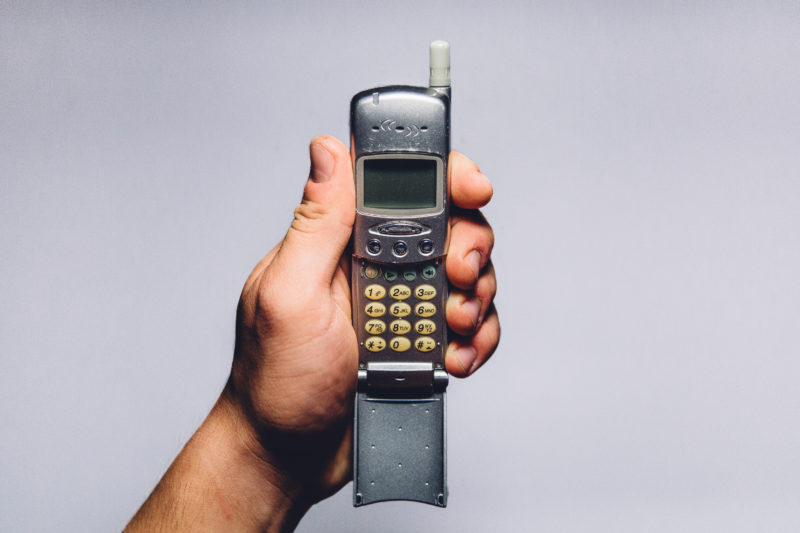 Holding an old cell phone
